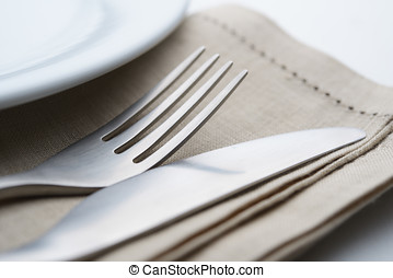 Table setting - Fork and table knife on the napkin