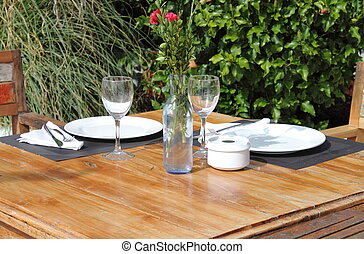 Table setting in a garden with flowers