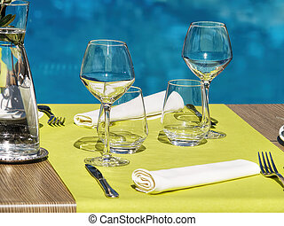 Table setting in a restaurant for 2 persons pool-side