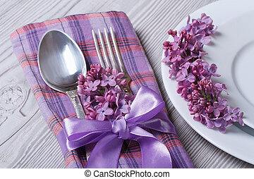 table setting in purple colors, decoration flowers lilacs -...
