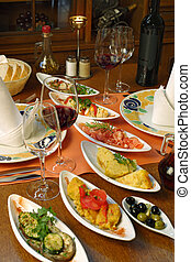 Table setting of Spanish tapas - A table setting full of...