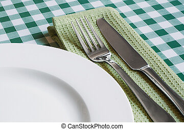 table setting on green Gingham table cloth