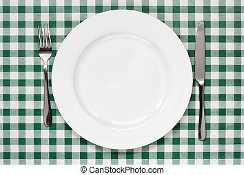 table setting on green Gingham tablecoth