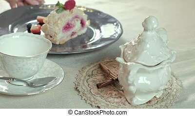 table setting, side view - table setting: arranging tea...