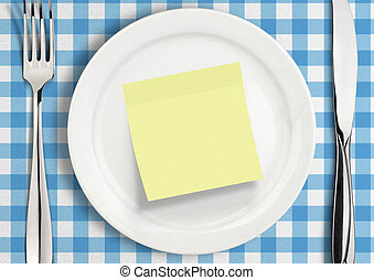 Table setting with blank note sticker on plate, reminder concept