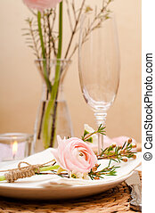 table setting with pink flowers