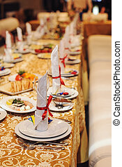 Table setting with red ribbon