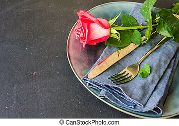 Table setting with red rose