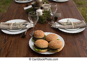 Table setting with served hamburgers