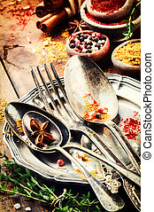 Table setting with vintage cutlery and colorful spices