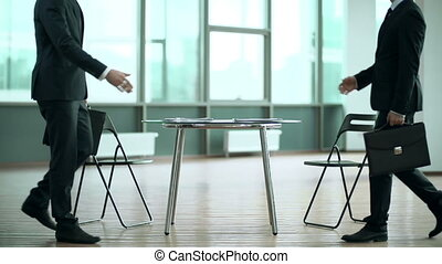 Table Top Meeting - Two businessmen starting negotiations at...