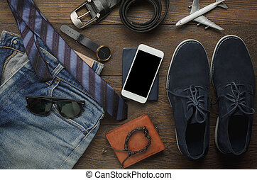 Table top view of accessories fashion men for travel with technology concept. Essential item for the teenage or adult gentlemen and travel for trip holidays. Mix of object on the modern rustic wooden.