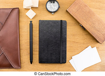 Table top with compass, wood box, notebook, leather bag, business card and pen, Template mock up for adding your word