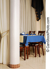 Table with a blue tablecloth