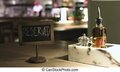 Table with a sign 'reserved' in a cafe