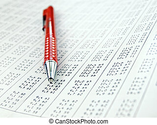 data table with red pen on it , close-up with shallow DOF