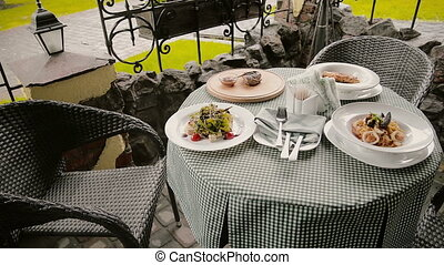 table with dishes in a cafe on the street