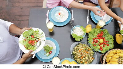 Table With Dishes Of Tropical Fruits And Salad Top Angle View People Group Eating Healthy Vegetarian Food Together