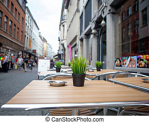 Table with flower in street cafe