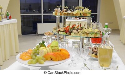 Table with food and glasses of juice - Buffet catering food...
