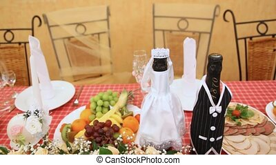 table with fruit and meat snack, champagne and flowers