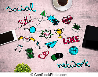 Table with social media icons - Top view of pink wooden...