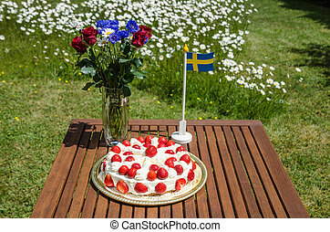 Table with strawberry cake and decorations