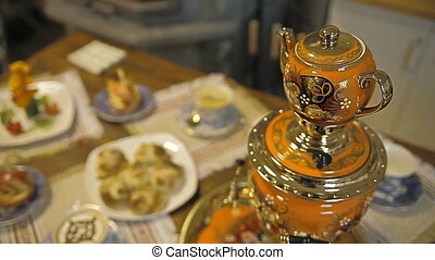 Table with sweets. Samovar with tea and pies