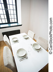 Table with table setting - White small table with four table...