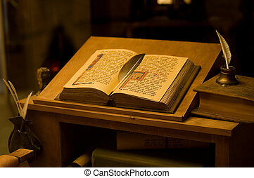 Table with the ancient book. vintage