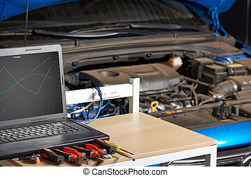 Table with tools for car electric diagnostic