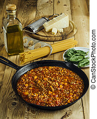 Table with traditional spaghetti bolognese ingredients