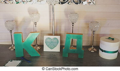 Table with wedding decor and letters.