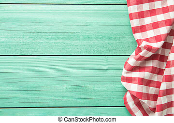 Tablecloth over colorful wooden table.