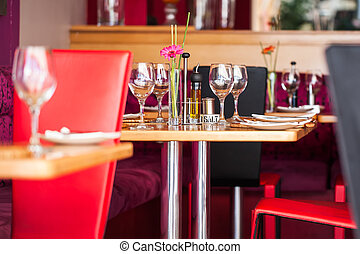 Tables - A table plated for four people at the most.