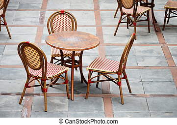 Tables and chairs in a street cafe
