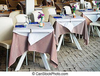 Tables at Cozy street cafe in Siracusa, Sicily, Italy