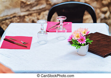 Tables at Cozy street cafe of Siracusa, Sicily, Italy