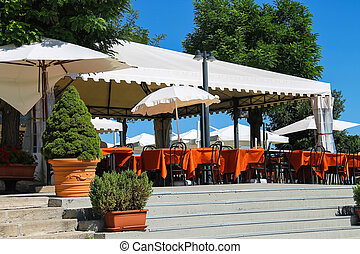 Tables outdoor restaurant in the fortress of San Marino.