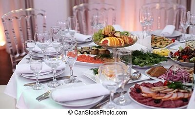 Tables set for an event party or wedding reception. luxury...