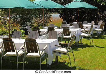 Garden Party - Tables set up for a Garden Party with green...