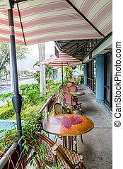 Tables Under Umbrellas on Tropical Patio