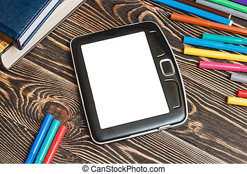 Tablet and School Supplies on Wooden Background