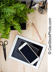 tablet and smartphone on office table