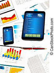 tablet, cell phone and financial documents