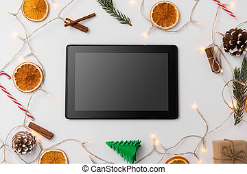 tablet computer, garland and christmas decorations