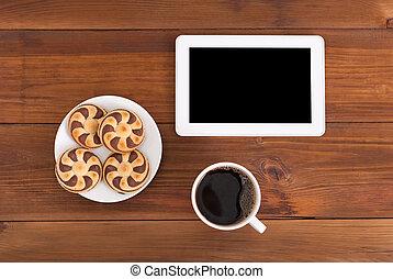 tablet, computer, koffie, en, koekjes, op, de, houten, tafel.