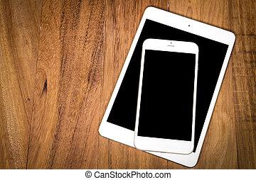 tablet, computer, met, mobiele telefoon, op, wooden table