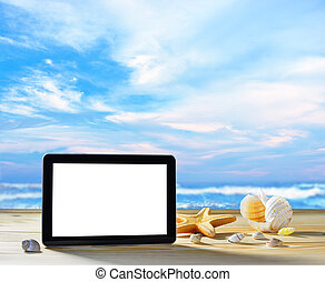 Tablet computer on the beach