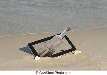 Tablet computer on the beach, with a message inside